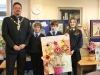 Year 7 students with recycled flower picture